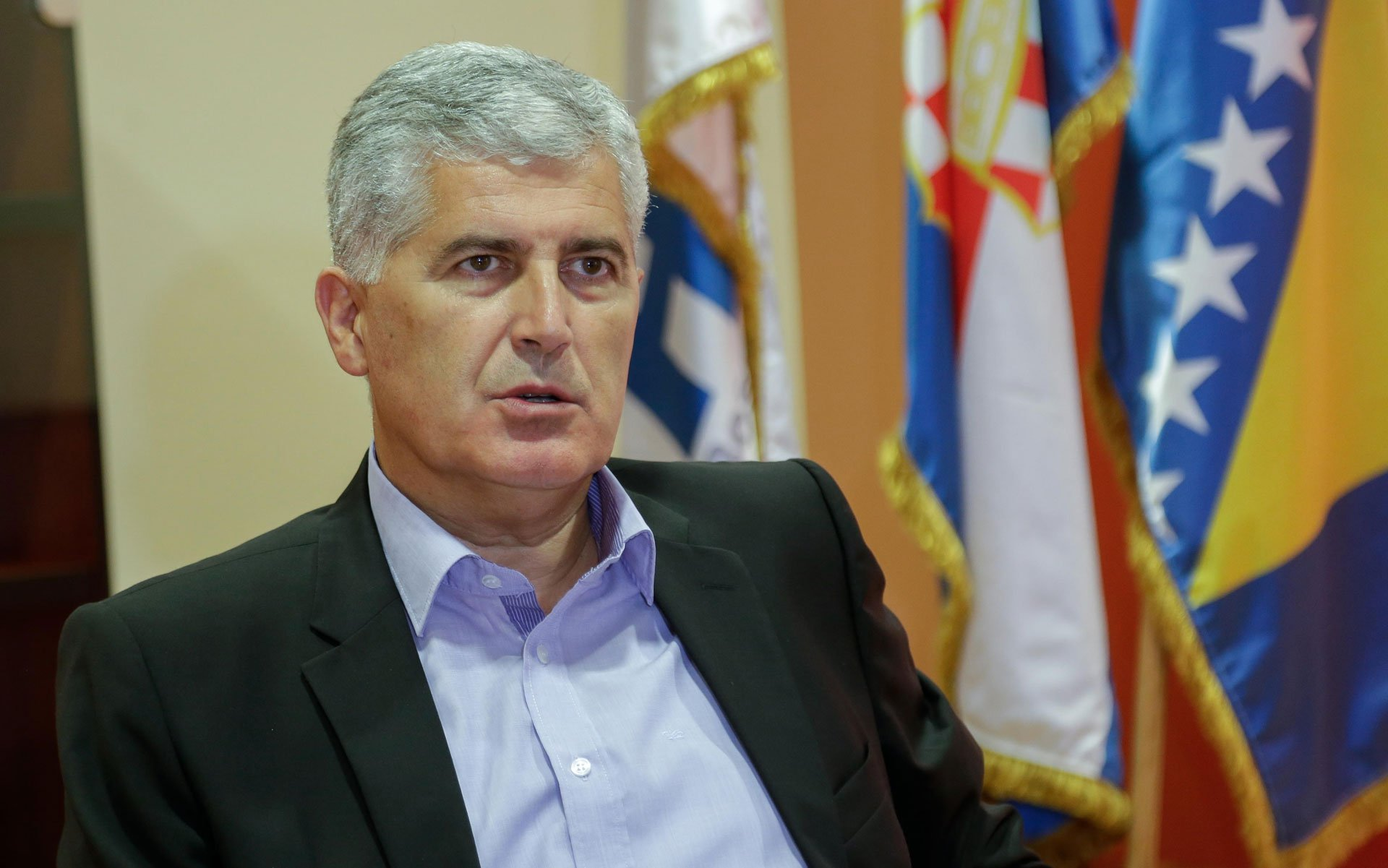 Newly elected President of Croatian National Parliament and President of HDZ political party (Croatian Democratic Union) Dragan Covic listens during a news conference after a meeting in Mostar April 19, 2011. Bosnian Croat major political parties meet in the ethnically-divided southern town of Mostar to re-establish a national body that will politically coordinate Croat-dominated regions of Bosnia, a move seen as the first step towards a Croat autonomy in Bosnia. More than 15 years after the 1992-95 war, Bosnia's three ethnic groups seem to have ever distant visions of the country's future, with Serb and Croat nationalists calling for separate statelets in a decentralised country and Muslims favouring a united Bosnia. REUTERS/Dado Ruvic (BOSNIA AND HERZEGOVINA - Tags: POLITICS)